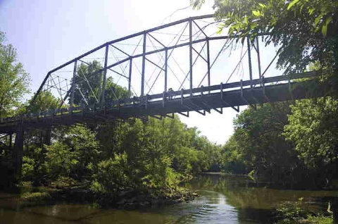 historic camelback truss bridge over Deep River